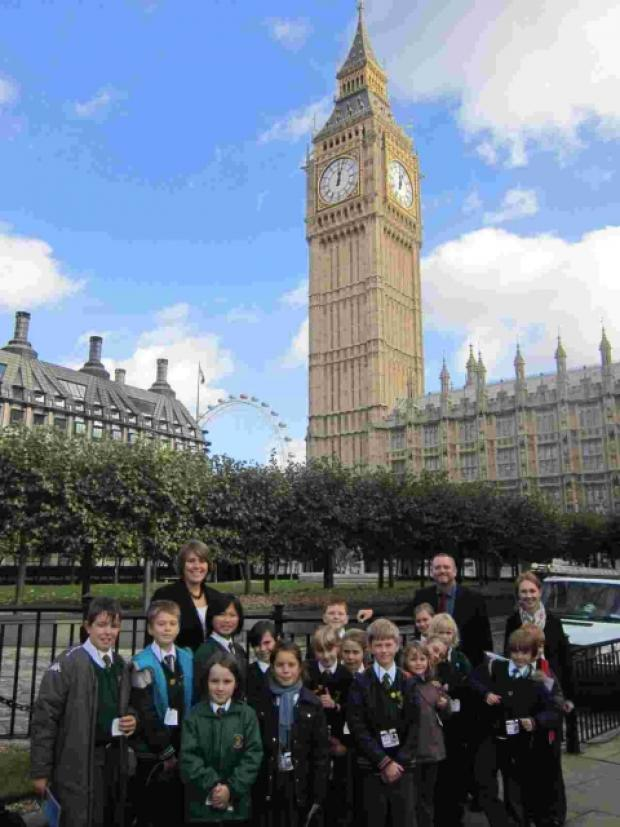 Pupils and staff with Big Ben in the background.