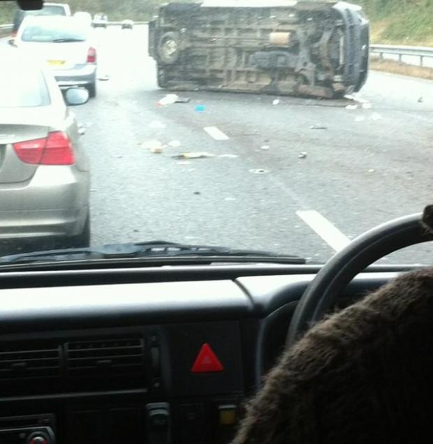 This is The West Country: A flipped car on the M5.