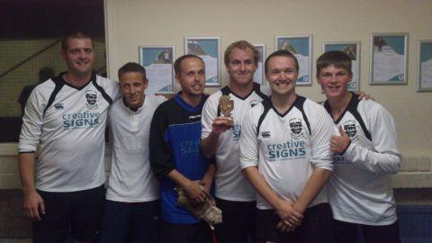 The winners of the tournament, Camborne Park FC, with their trophy.