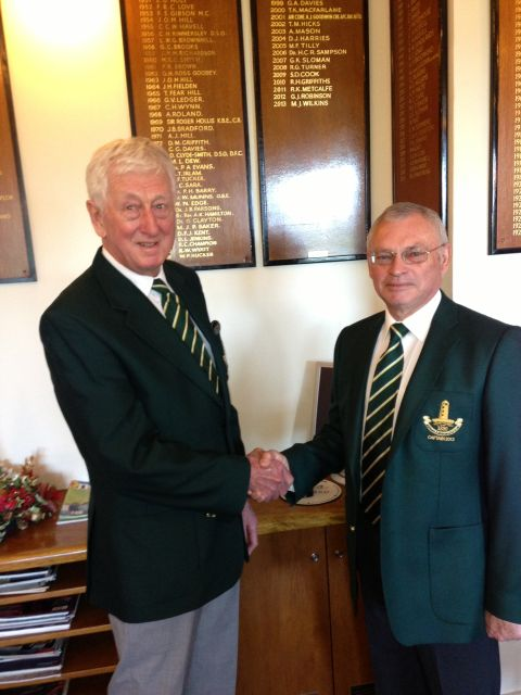 PHOTO: Submitted - Martin collects his green jacket from 2012 captain Geoff Robinson.