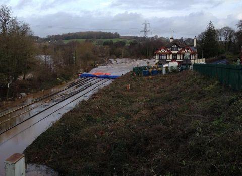 This is The West Country: Inflatable dams kept the flood water at bay at Cowley Bridge, near Tiverton