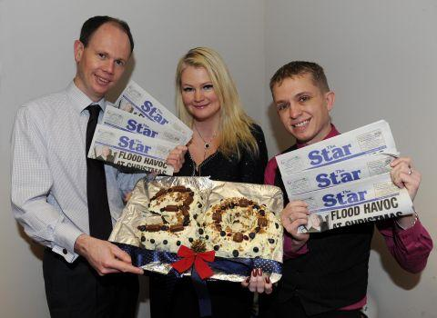 This is The West Country: Editor Alex Cameron, advertising manager Sharon Mitchell and retail representative Mike Bird are pictured with a specially-prepared cake to mark the occasion