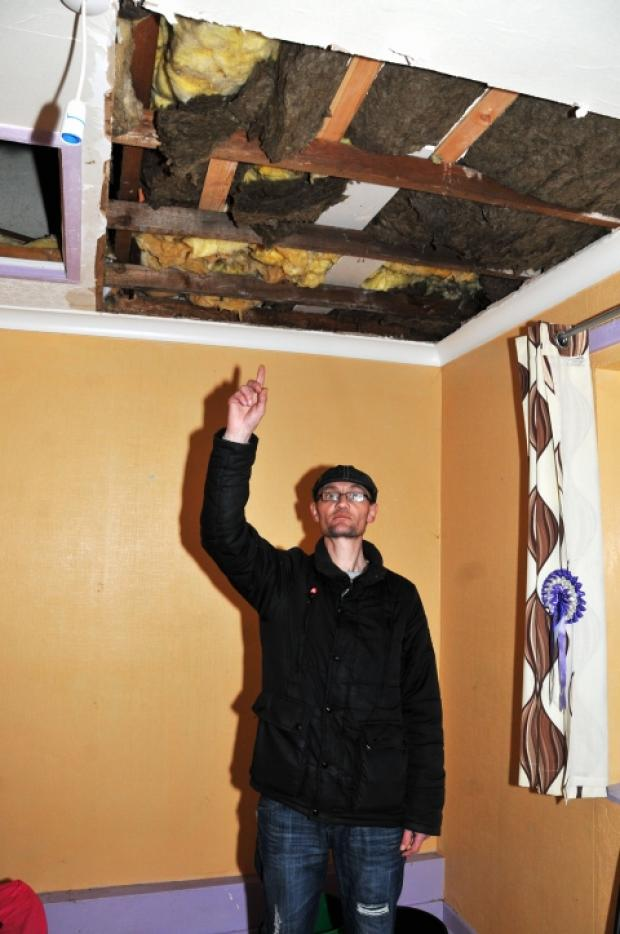This is The West Country: David Beebe shows the hole in his daughter's bedroom ceiling.
