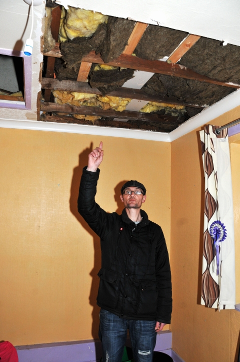 David Beebe shows the hole in his daughter's bedroom ceiling.