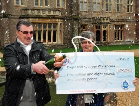 Roger and Kath Whitehouse celebrate with a glass of bubbly at St Audries Park Hotel, West Quantoxhead. PHOTO: Jeff Searle.