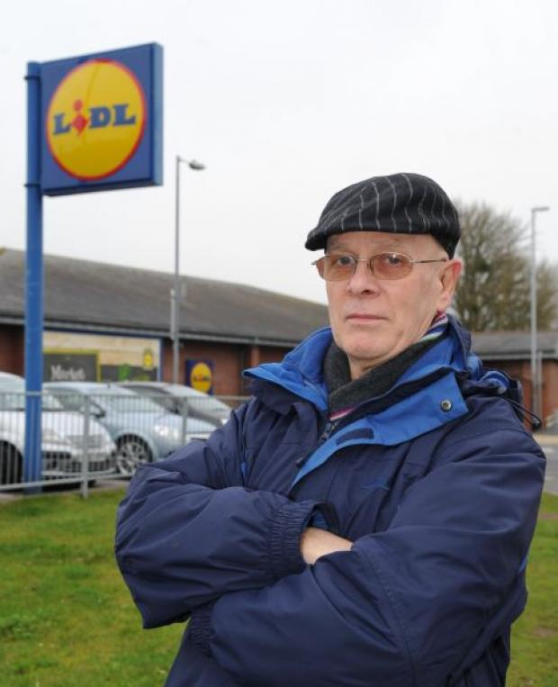 This is The West Country: John Kerswell next to the Wood Street Lidl store.