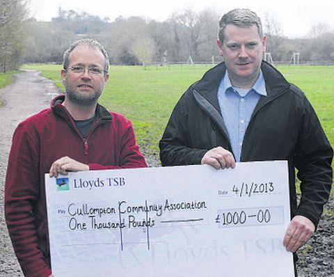 STAN Wallis (left) from the Preston Down Trust, hands a cheque to Ashley Wilce, chairman Cullompton Community Association.