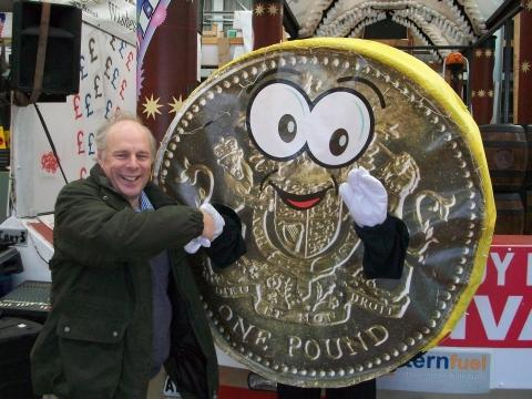 Bridgwater MP Ian Liddell-Grainger congratulates charity mascot Pete the Pound.