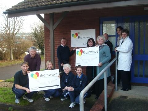 Staff at Brainwave have put up new signs at their Huntworth base, thanks to a donation from Irwin Mitchell solicitors.