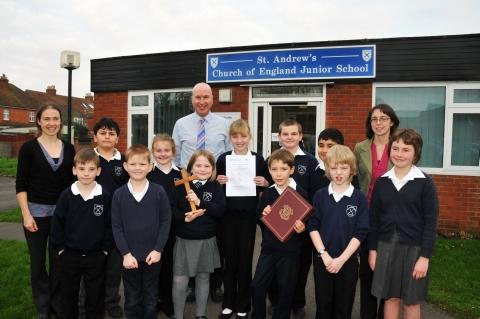 L to R: Ali Pook, deputy head, Gavin Morris, head teacher, and Christine Collett, assistant head, with the children from St Andrew's Church of England Junior School. Photo: Jeff Searle.