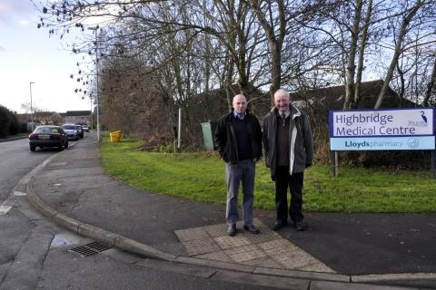 Cllrs John Woodman and Chris Williams in Pepperall Road adjacent to Highbridge Medical Centre. Photo: Mike Lang.