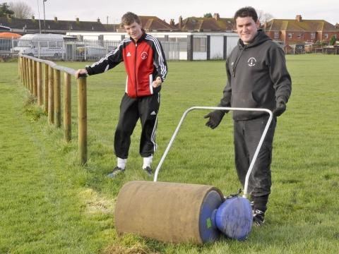 Burnham United player Warren Mylum with assistant manager John Harding.