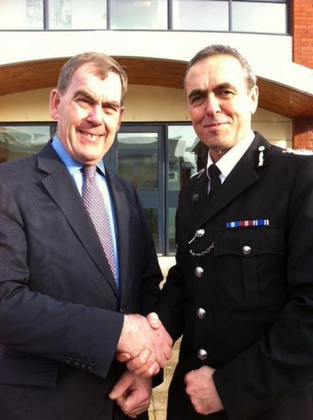 Devon and Cornwall's Police and Crime Commissioner Tony Hogg (left) congratulates Shaun Sawyer on his selection as chief constable