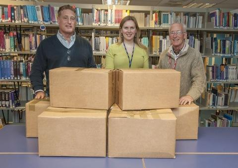 Richard and Jonathon Meads accepting the latest donation of books from Jolanta Peters.