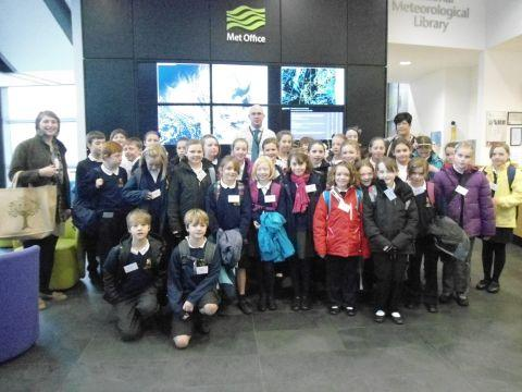 PIC: Will Lang (back centre) gives North Curry teachers and pupils a tour of the Met Office weather centre in Exeter.