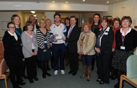 Olympic BMX star Liam Phillips with the OSNA fund committee and cheque for £3,000. PHOTO: Geoff Hal