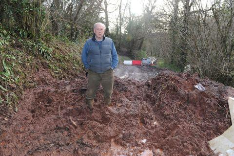 This is The West Country: Chris Prentis standing on the pile of mud dumped near his Mid Devon home by Devon County Council contractors
