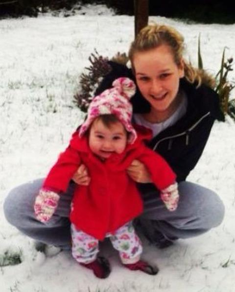Maddison enjoys snow for the first time with her mum, Tamsin.