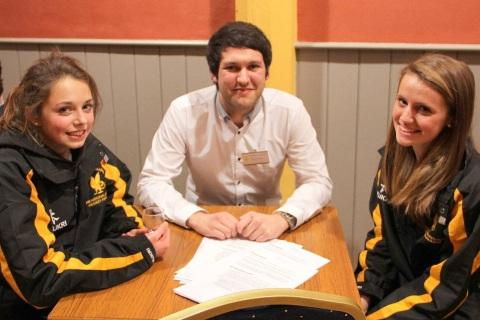 Reporter Michael Marsh with students.
