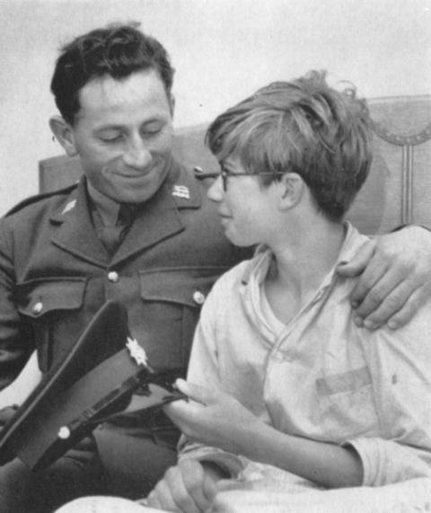 Cpl Geoffrey Booth with Michael Webber, the 14-year-old boy he rescued in 1964. PHOTO: The Green Tiger