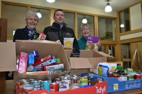 Chrissie Payne, left, (Food Cupboard coordinator), Neil Bliss (Magna West Somerset) and Cath Babbege (Food Cupboard volunteer) sorting donations.