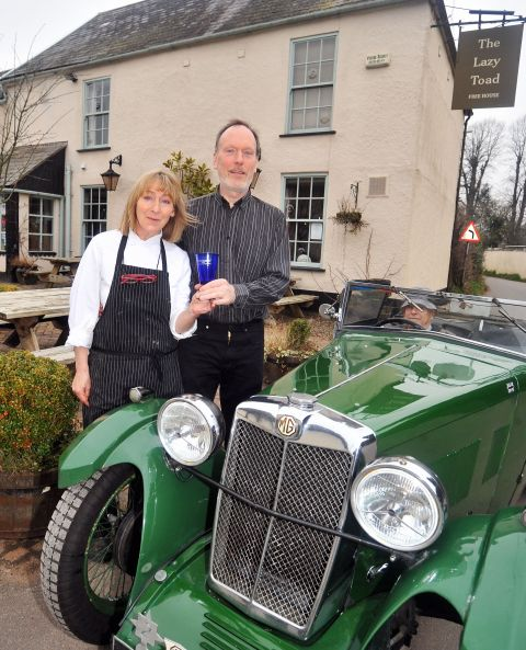 Husband and wife landlords Clive and Mo Walker, who are celebrating after The Lazy Toad pub in Brampford Speke won a silver medal at the South West Tourism Excellence Awards
