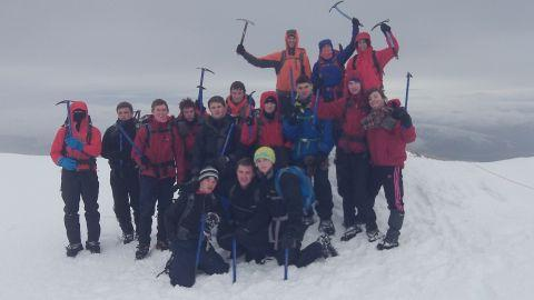 The team take well-earned break while trekking through the snow
