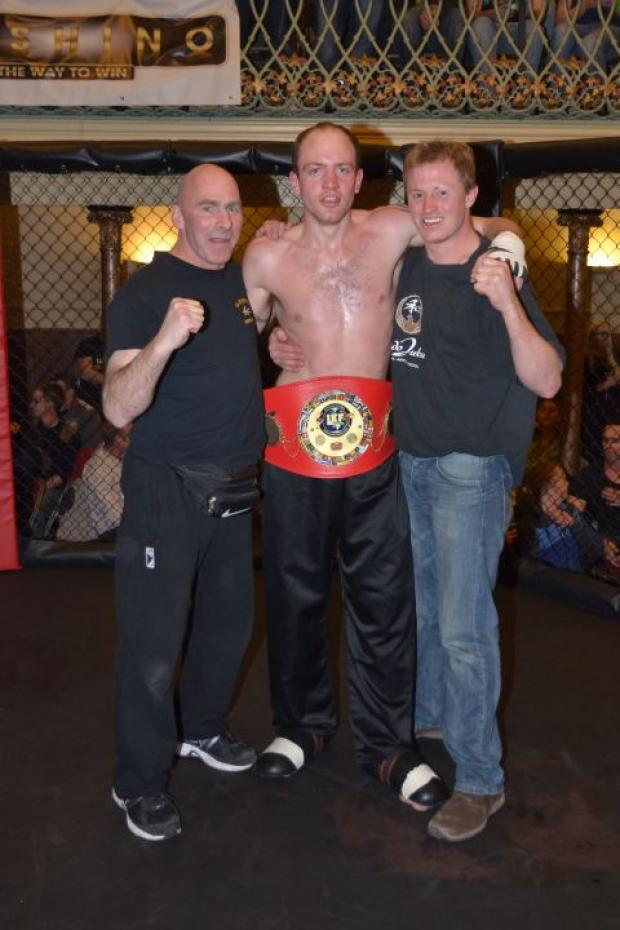 Chris James (centre) wins the British Title fight in style at Bridgwater Town Hall.