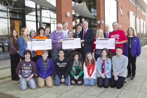 This is The West Country: Representatives of the three chosen charities being presented their cheques by College Principal Mike Robbins with Student Support staff and Students' Union representatives, including President Georgia Hodges (pictured next to Principal). Photo: submitt