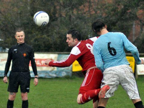 Craig Hirons leaps for the ball