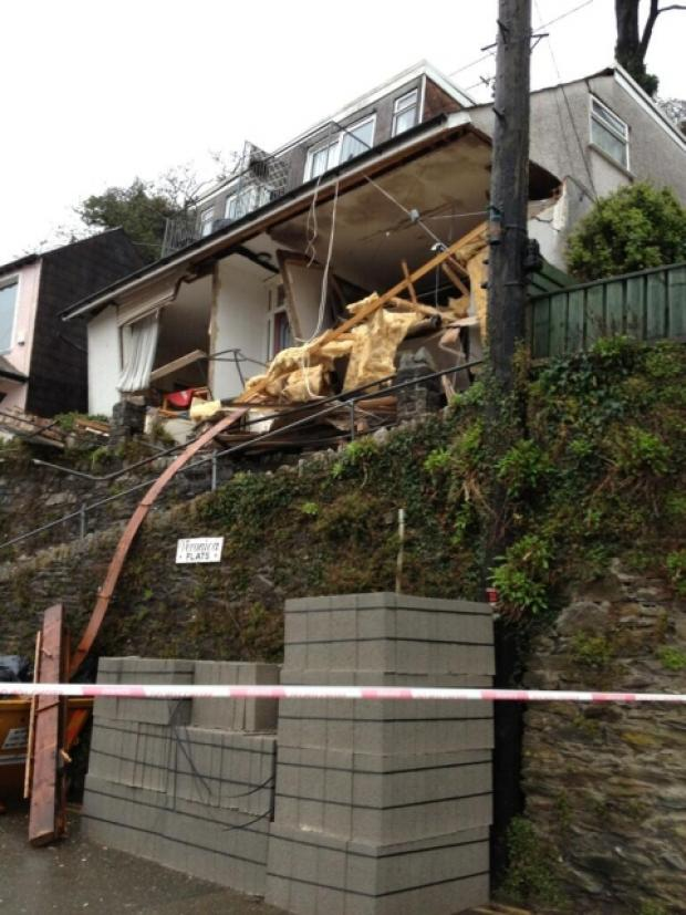 Landslide causes block of flats to collapse in Looe: 'Woman trapped inside'