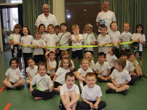 Avenue Tennis coaches with youngsters at Berrow Infants School.