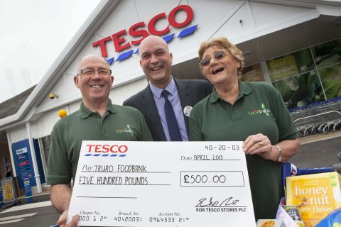 Foodbank donation and Peppa Pig visit mark Truro supermarket re-opening
