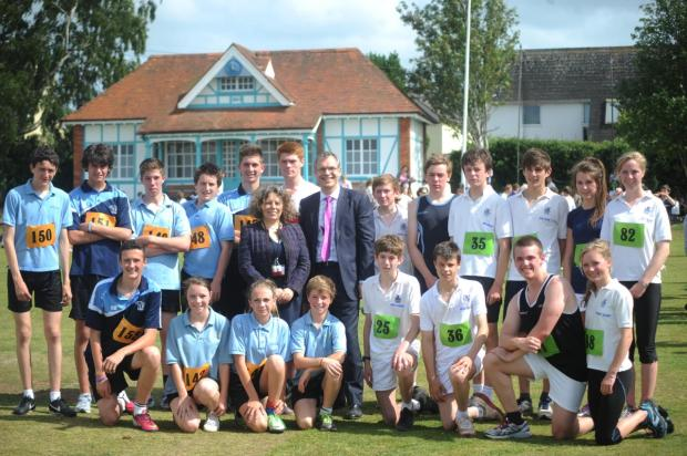 This is The West Country: Wellington School headmaster Martin Reader, wearing pink tie, with head teacher of Court Fields Elaine Faull and runners.