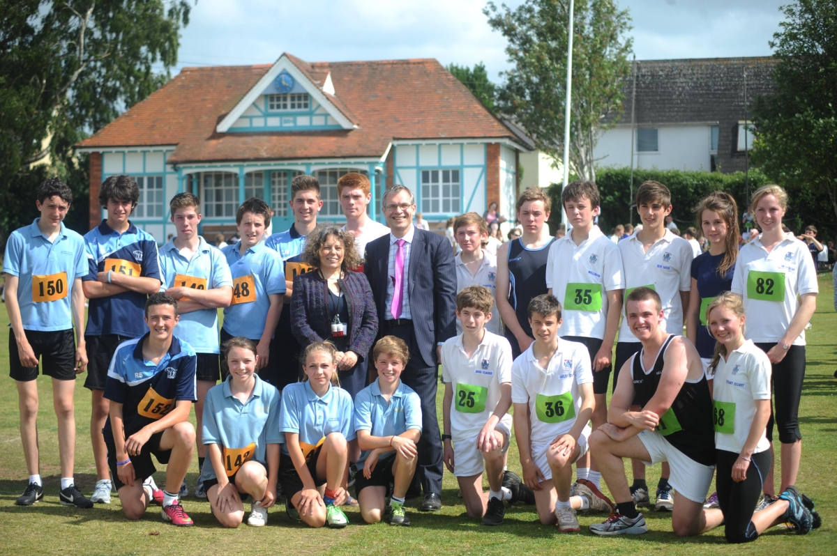 Wellington School headmaster Martin Reader, wearing pink tie, with head teacher of Court Fields Elaine Faull and runners.