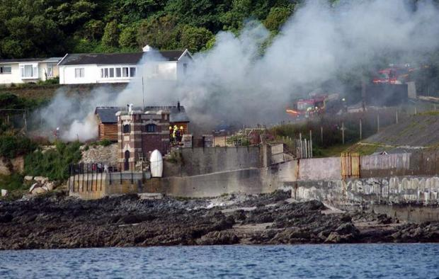 This is The West Country: Fire crews tackle the shed fire on Pendennis Point. Credit: Orca Sea Safaris