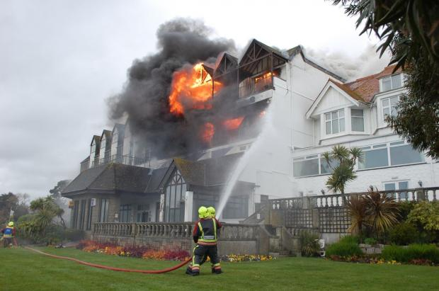 This is The West Country: Falmouth Beach Hotel went up in smoke in April last year. Credit: Greg Fountain