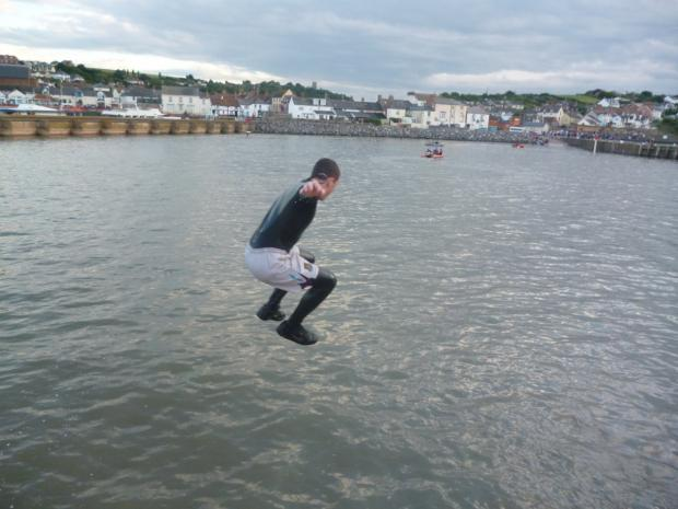 A YOUNGSTER jumps into the sea at Watchet.