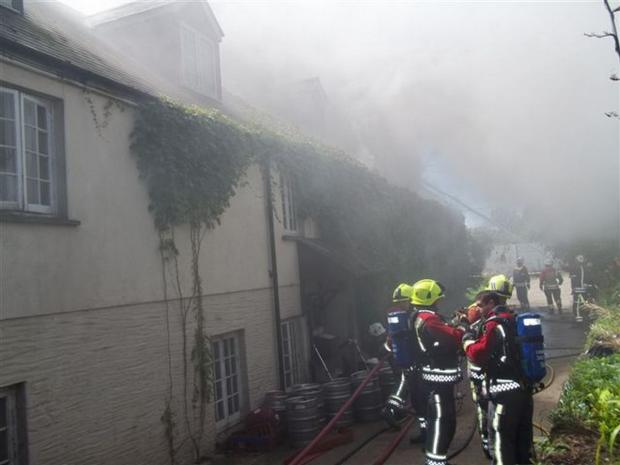 Eleven crews tackle huge manor house fire as help called in from Devon and Somerset