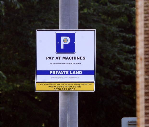 Council defends overnight parking charges