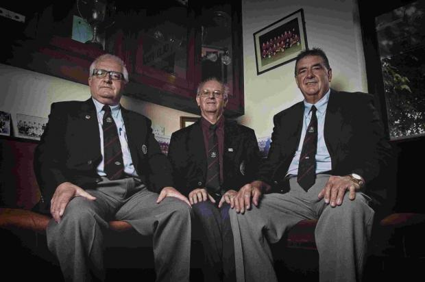 (From left to right) Penryn Athletic's founders Mike Young, Anthony Retallack, and Peter Young pictured in 'Fogey's Corner' at their Kernick Road clubhouse in Penryn