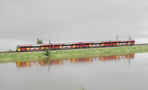 A train tries to makes its way through the floods