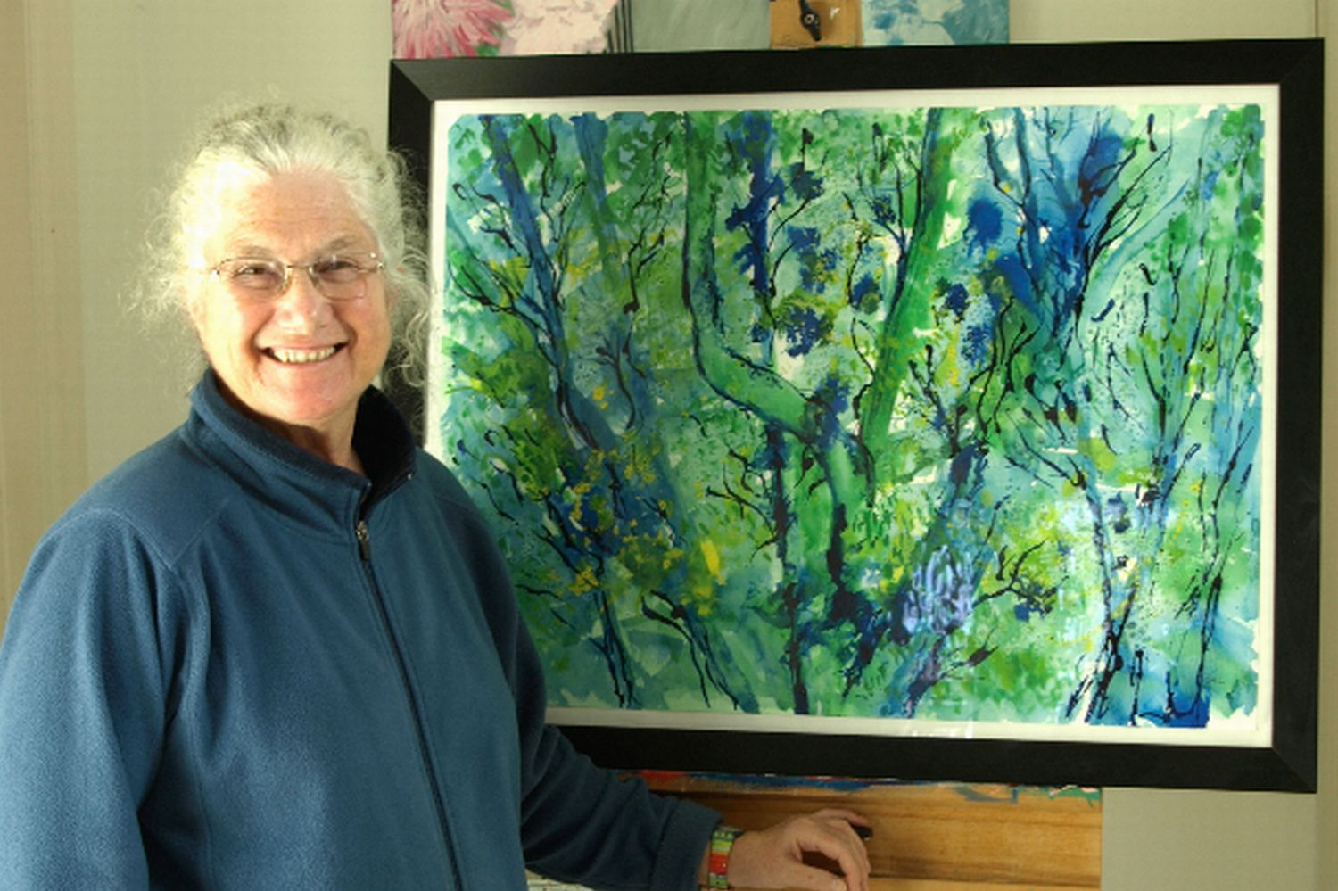 SUE Hammond-Lovatt with with 'Woodland Walk', a work in acrylic ink on watercolour paper.