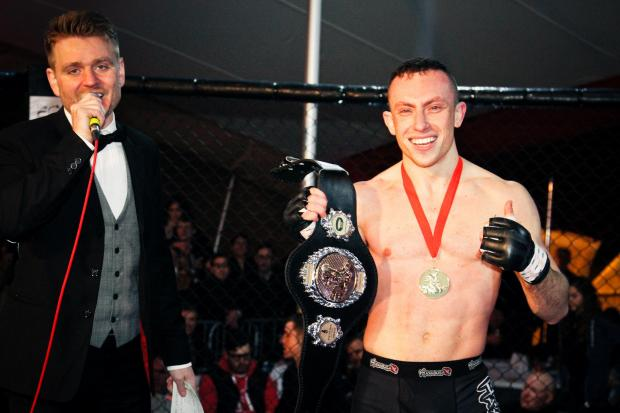 Richard Buskin after winning the lightweight UFW champion belt (David Itzcovitz Photography)