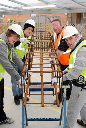 HARRY Taylor, John McPhilbin, instructor Terry Hall and Pete Goldsmith taking part in the Pathways to Employment steel fixing and general construction classes. PHOTO: Steve Guscott.