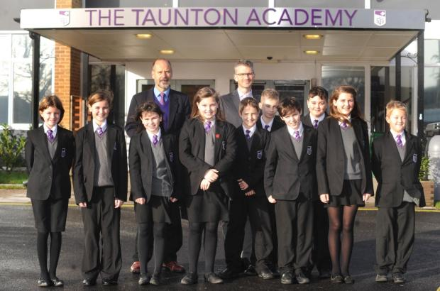 Marcus Paul, back left, with Taunton Academy chaplain the Rev Mike Haslam and students.