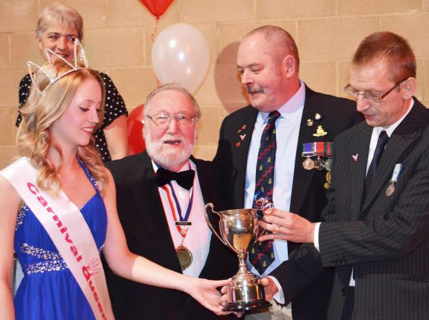 Carnival Queen Emma Nicholson presenting the trophy to Guy Ford and Martin Heale with Committee President Martin Borland.