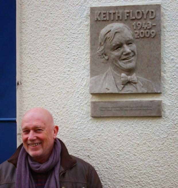 This is The West Country: Sculptor John Alder next to the plaque of Keith Floyd, in Silver Street.