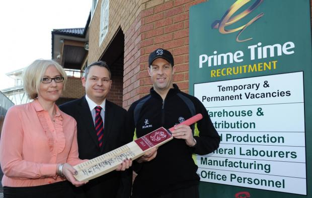 Somerset Cricket Club captain Marcus Trescothick hands over signed bat to lucky raffle winner