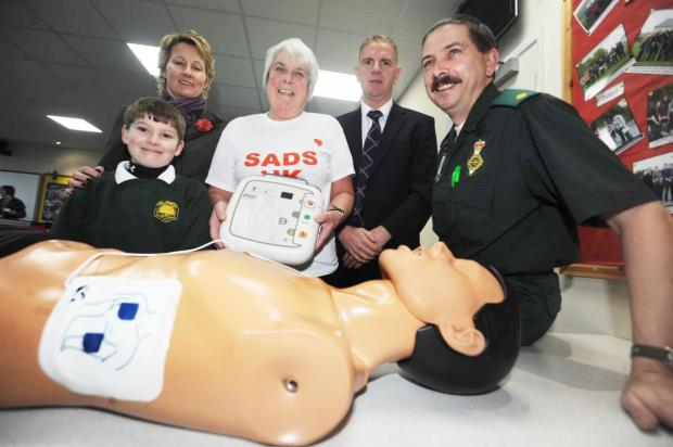 CHARLIE and Linda Kellaway with Holyrood Academy's medical room assistant Jennifer Gent, head teacher Martin Brook and Tom Jackson, assistant community responder officer at a defibrillator training session.